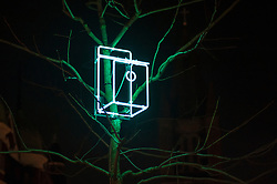 "© Licensed to London News Pictures. 15/01/2016. London, UK.  Neon bird nesting boxes represent ""Sanctuary"" by Sarah Blood near Bond Street.  The work forms part of Lumiere London, a major new light festival which is into the second of four evenings and featuring artists who work with light.  The event is produced by Artichoke and supported by the Mayor of London.  Photo credit : Stephen Chung/LNP"