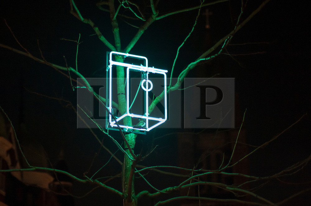 """© Licensed to London News Pictures. 15/01/2016. London, UK.  Neon bird nesting boxes represent """"Sanctuary"""" by Sarah Blood near Bond Street.  The work forms part of Lumiere London, a major new light festival which is into the second of four evenings and featuring artists who work with light.  The event is produced by Artichoke and supported by the Mayor of London.  Photo credit : Stephen Chung/LNP"""