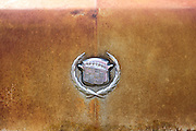 Rust and auto marque logo badge on rusty limo at The Shack Up Inn cotton sharecroppers theme hotel, Clarksdale, Mississippi, USA