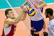 (R) Earvin Ngapeth from France attacks against (L) Dmitriy Muserskiy from Russia during the 2013 CEV VELUX Volleyball European Championship match between Russia v France at Ergo Arena in Gdansk on September 25, 2013.<br /> <br /> Poland, Gdansk, September 25, 2013<br /> <br /> Picture also available in RAW (NEF) or TIFF format on special request.<br /> <br /> For editorial use only. Any commercial or promotional use requires permission.<br /> <br /> Mandatory credit:<br /> Photo by © Adam Nurkiewicz / Mediasport