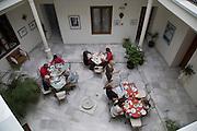 Historic building interior, Hotel Casa Grande, Jerez de la Frontera, Spain looking down  courtyard people eating breakfast