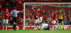 27.09.2011, Old Trafford, London, ENG, UEFA CL, Gruppe C, Manchester United (ENG) vs FC Basel (SUI), im Bild Manchester United's Rio Ferdinand, Antonio Valencia, Nani and goalkeeper David de Gea look dejected as Paolo Tagliavento awards FC Basel 1893's captain Marco Streller a penalty kick // during the UEFA Champions League game, group C, Manchester United (ENG) vs FC Basel (SUI) at Old Trafford stadium in London, United Kingdom on 2011/09/27. EXPA Pictures © 2011, PhotoCredit: EXPA/ Propaganda Photo/ David Rawcliff +++++ ATTENTION - OUT OF ENGLAND/GBR+++++
