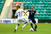 Hayley Lauder (#7) of Scotland looks to pass the ball around the challenge of Eleni Giannou (#7) of Cyprus during the Women's Euro Qualifiers match between Scotland Women and Cyprus Women at Easter Road, Edinburgh, Scotland on 30 August 2019.