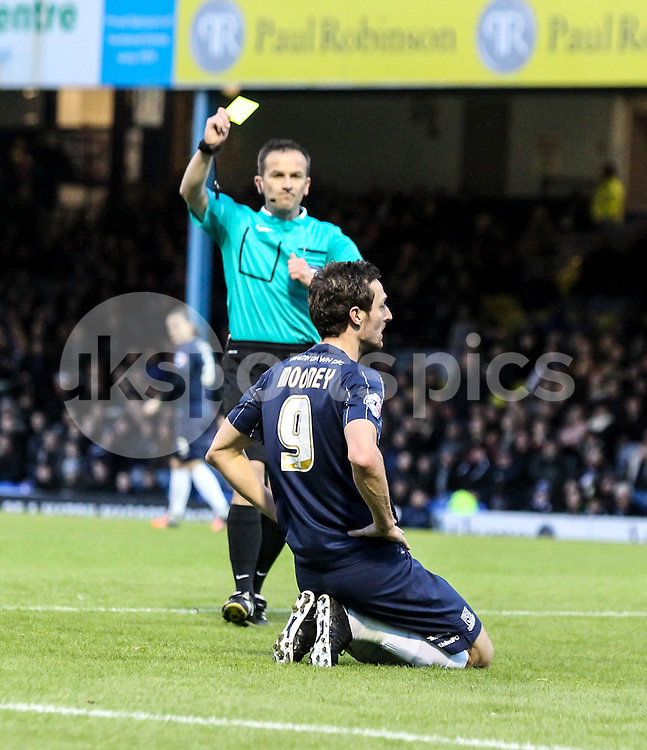 David Mooney of Southend United gets a yellow card for diving in the box during the Sky Bet League 1 match between Southend United and Wigan Athletic at Roots Hall, Southend, England on the 28th November 2015. Photo by Ken Sparks.