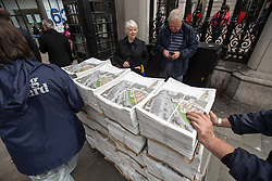 © Licensed to London News Pictures . 17/04/2013 . London , UK . Hundreds of copies of the Evening Standard with the funeral procession of Baroness Thatcher pictured on the front are wheeled next to Charing Cross Station . The funeral of former British Conservative Prime Minister , Baroness Margaret Thatcher , today (Wednesday 17th April 2013) in Central London . Baroness Thatcher died from a stroke at the age of 87 . Photo credit : Joel Goodman/LNP