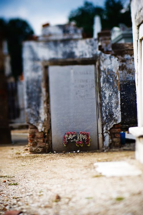 New Orleans grave stone St Louis Cemetery photograph taken with lens baby