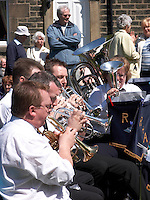 Brass band playing on village green in Rivington, Lancashire.