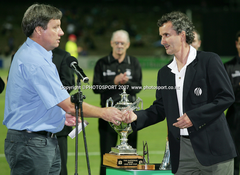 NZ Cricket CEO Martin Snedden presents umpire Billy Bowden with an award during the prizegiving after the 3rd Chappell-Hadlee Trophy one day cricket match between New Zealand and Australia at Seddon Park, Hamilton, New Zealand on Tuesday 20 February 2007. Photo: Stephen Barker/PHOTOSPORT<br /> <br /> <br /> 200207