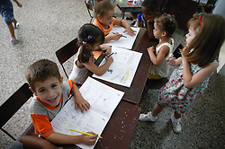 Children with crayons at Havana nursery school,
