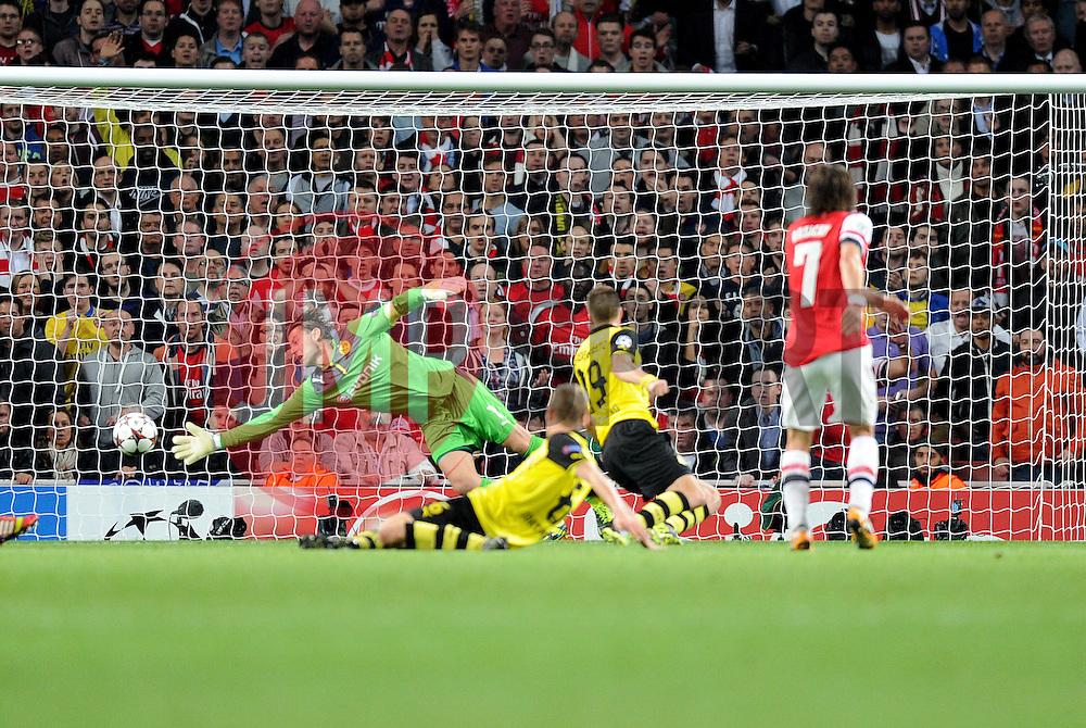 Borrusia Dortmund's Roman Weidenfeller manges to stop Arsenal's Tomas Rosicky shot on goal. - Photo mandatory by-line: Alex James/JMP - Tel: Mobile: 07966 386802 22/10/2013 - SPORT - FOOTBALL - Emirates Stadium - London - Arsenal v Borussia Dortmund - CHAMPIONS LEAGUE - GROUP F