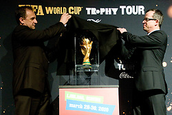 President of Slovenian football federation Ivan Simic and Uros Kanduc, general manager of Coca Cola Slovenija removing the cover of the trophy at VIP reception of FIFA World Cup Trophy Tour by Coca-Cola, on March 29, 2010, in BTC City, Ljubljana, Slovenia.  (Photo by Vid Ponikvar / Sportida)