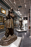 In the foreground is a bronze sculpture of Ivan Mestrovic by American Malvina Hoffman, an American student of Auguste Rodin,  in the Luce Center for American Art Visible Storage Study Collection of the Brooklyn Museum.