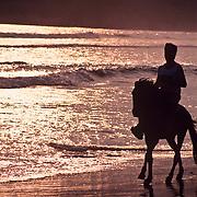 Horseback riding on the beach. Revolcadero Beach. Acapulco, Guerrero. Mexico.