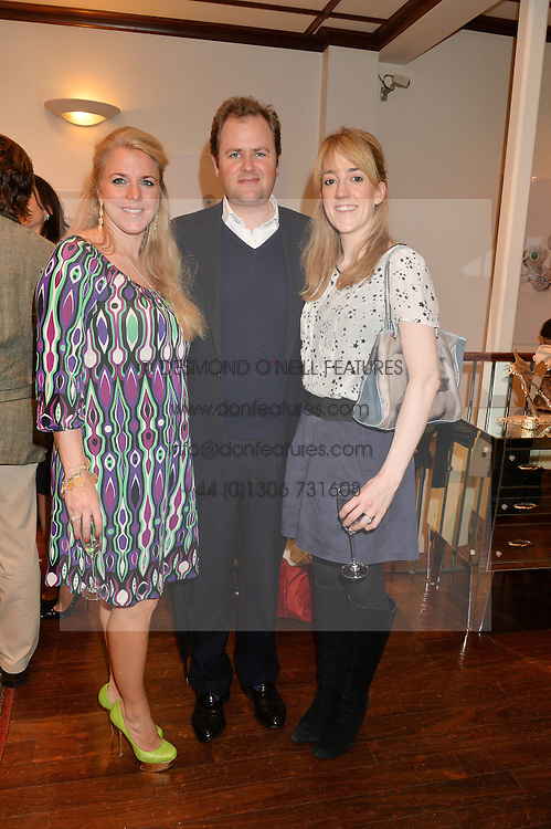 Left to right, ALEXANDRA MAVROS, the HON.MICHAEL MARSHAM and his wife the HON.LUCY MARSHAM  at a pre christmas party & shopping evening at Patrick Mavros, 104-106 Fulham Road, London on 26th November 2014.