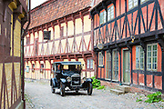 Vintage car Model T Ford at Den Gamle By, The Old Town, and half-timbered buildings at open-air folk museum at Aarhus in Denmark