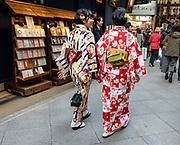 Kimono clad women in Teramachi Kyogoku Shopping Arcade, Kyoto, Japan.