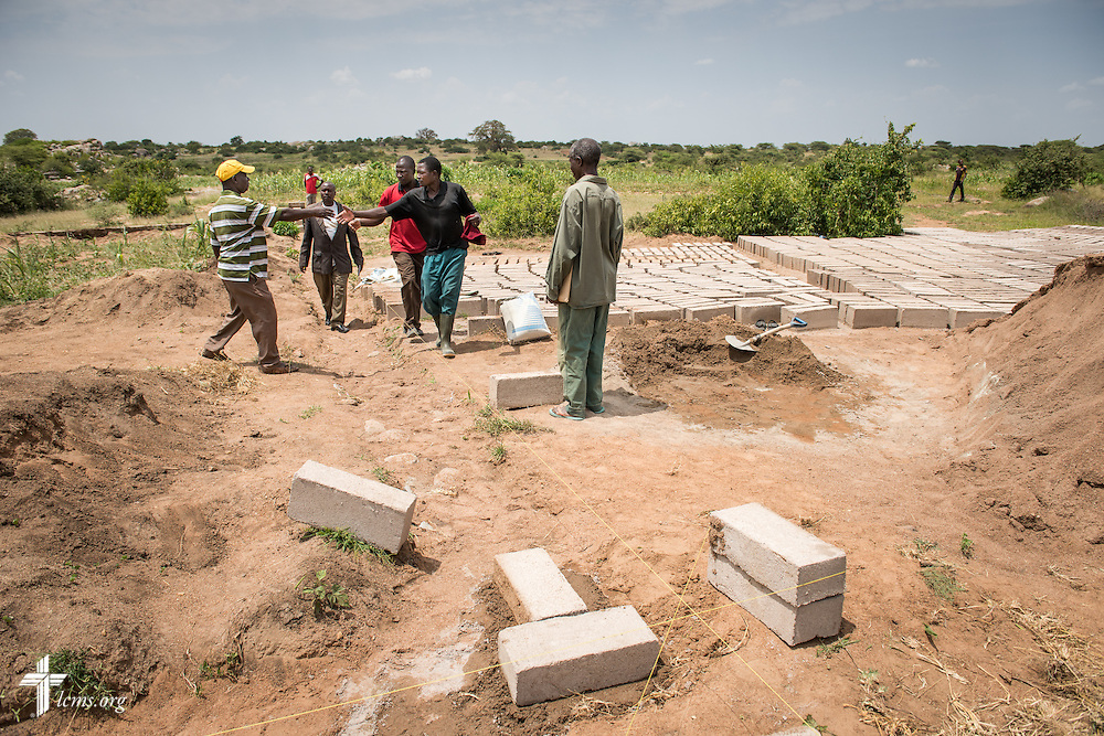 Workers construct the Ikonongo Lutheran Church of the Evangelical Lutheran Church in Tanzania – South-East of Lake Victoria Diocese (ELCT-SELVD on Friday, March 13, 2015, in Shinyanga region, Tanzania. LCMS Communications/Erik M. Lunsford