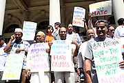 26 August 2010- New York, NY--Taxi Drivers Demonstrate on the steps of City Hall to denounce violent hate crimes against Taxi Drivers in New York City. ..Taxi Cab Driver Ahmed Sharif was slashed and stabbed by a passenger who first asked if he were muslim, and then savagely stabbed him 5 times over  his face, throat and arms by 21year-old Michael Enright, a College Student at School of Visual Arts who had just returned from Afghanistan.