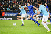 Leicester City defender Harry Maguire (15) takes on Manchester City defender John Stones (5) during the quarter final of the EFL Cup match between Leicester City and Manchester City at the King Power Stadium, Leicester, England on 18 December 2018.