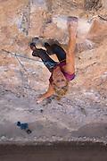 "Legendary climber Lynn Hill climbing ""Hang Em High"" 12c, Project Wall, Rifle Mountain Park, Rifle Colorado."