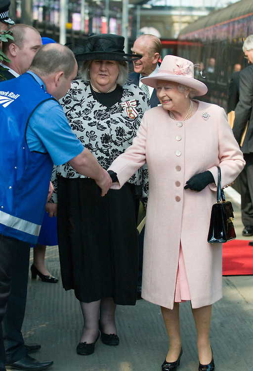 Liverpool, England May 22nd  Her Majesty Queen Elizabeth II accompanied by The Duke of Edinburgh  arrives at Livepool  Train Station ahead of engagements in the city