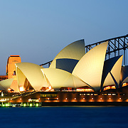 Sydney Opera House and Sydney Harbour Bridge in the background as seen from rom Mrs. Macquarie's Point at night