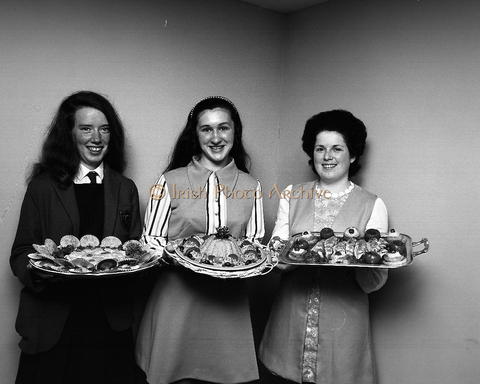 "B.I.M.National Seafood Cook..1972..05.05.1972..05.05.1972..5th May 1972..The final of the ""National Seafood Cook 1972"" was held in the Great Southern Hotel,Killarney,Co Kerry.The winner was Miss Mary Coleman (14 years)from the Vocational School, Claremorris,Co Mayo.The title of the winning dish was ""Amber Ring. She was chosen from 18 regional finalists...From left,The award winners pose with their Dishes,Maria Geoghegan (3rd) ""Catch of the Season"", Mary Coleman (1st) ""Amber Ring"" and Celine O'Reilly (2nd) ""India Gold""."