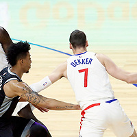 26 December 2017: LA Clippers forward Sam Dekker (7) drives past Sacramento Kings guard Malachi Richardson (23) on a screen set by LA Clippers forward Montrezl Harrell (5) during the LA Clippers 122-95 victory over the Sacramento Kings, at the Staples Center, Los Angeles, California, USA.