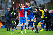 Coll Donaldson (#5) and Jamie McCart (#6) of Inverness Caledonian Thistle FC celebrate winning at the final whistle of the William Hill Scottish Cup quarter final match between Dundee United and Inverness CT at Tannadice Park, Dundee, Scotland on 3 March 2019.
