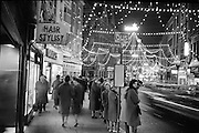 Waiting for the bus under the Christmas lights, Grafton Street, Dublin..09.12.1961