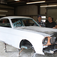 JOHN WARD/BUY AT PHOTOS.MONROECOUNTYJOURNAL.COM <br /> Joe Comer, left, stands with his son, Dee, behind a 1956 Ford Mustang fastback undergoing a complete restoration at their shop on Central Grove Road.