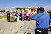 ULAN BATOR, MONGOLIA..08/21/2001.Official wedding photo at Sukhbaatar Square, Government House in background..(Photo by Heimo Aga)