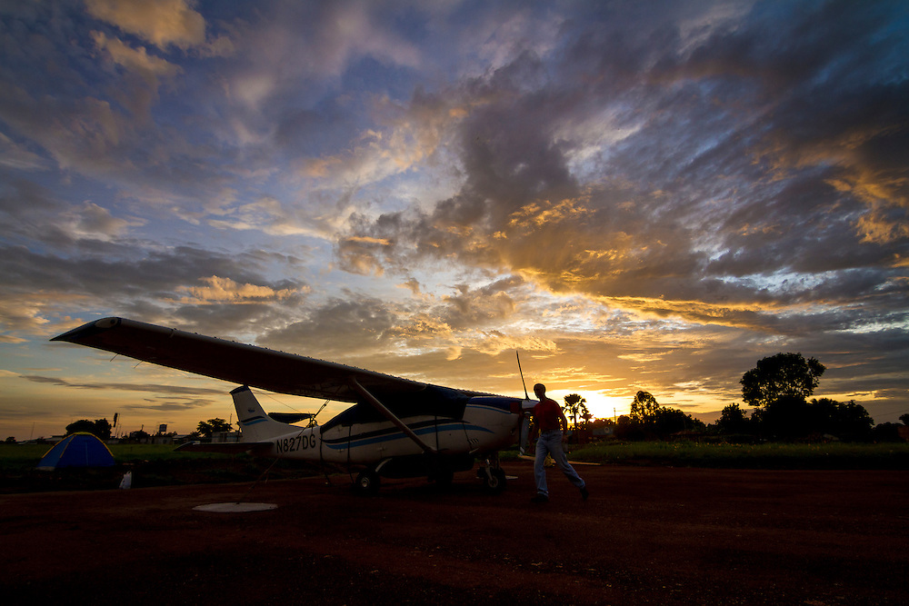 The sun breaks through the clouds in advance of an early-morning flight from Arua to Yida, South Sudan.