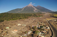 Damage to a village caused by the June 3, 2018 eruption of the Fuego volcano in Guatemala is shown in a drone photo on Saturday, Dec. 22, 2018. Work continues to repair RN 14, the route that passes through the zone damaged by the disaster.