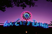 Fog City Diner sign at dusk with a clock that has DON'T WORRY instead of numbers, San Francisco, California, USA.