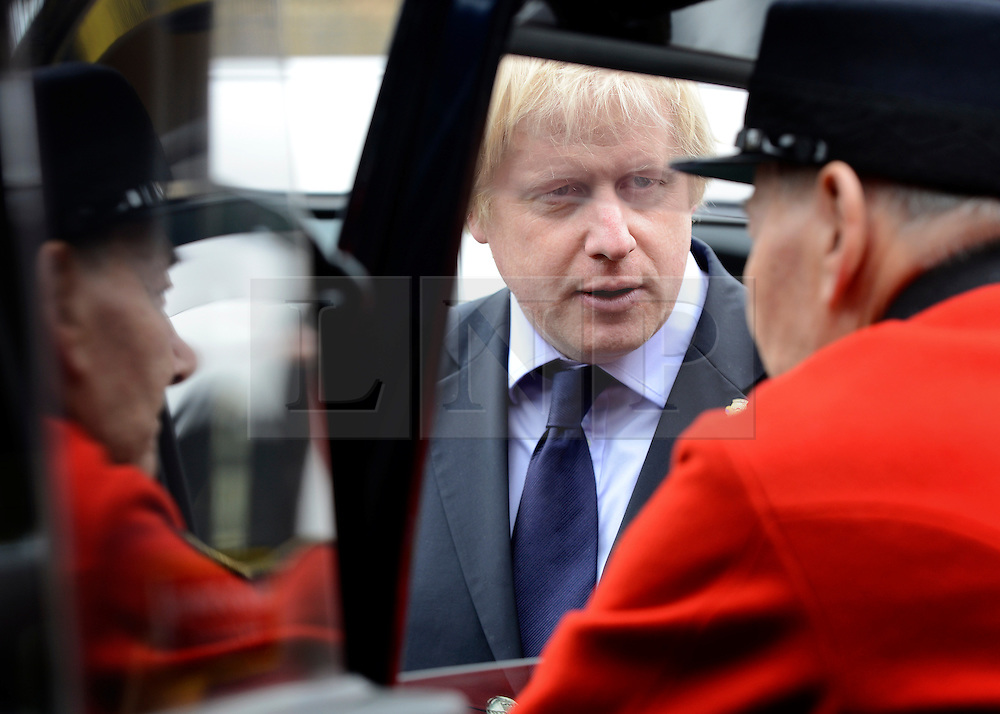 © Licensed to London News Pictures. 02/05/2012. London, UK Boris Johnston listens to a Chelsea Pensioners story through a cab window. London Mayor,Boris Johnsonis joined bycomedian Al Murrayto wave off an army ofWWII veterans who are embarking on an iconic trip to the Netherlands, via a convoy of black cabs.The London Taxi Benevolent Association for the War Disabled has organised a trip for 160 WWII veterans to travel to Holland in 80 London Black Cabs. The veterans, mostly aged between 85 and 94, will start their journey from London today 2nd May 2012 and will be visiting sites of importance from WWII and taking part in Dutch Liberation Day celebrations as guests of honour of the Dutch Royal Family.. Photo credit : Stephen Simpson/LNP