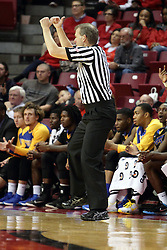 16 November 2015: Randy Heimerman signals a held ball and then looks at the scorers table for the indication arrow. Illinois State Redbirds host the Morehead State Eagles at Redbird Arena in Normal Illinois (Photo by Alan Look)