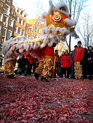 NETHERLANDS AMSTERDAM 02JAN09 - Chinese dragon performance and firecrackers welcome the new year in Amsterdam's red light district...jre/Photo by Jiri Rezac