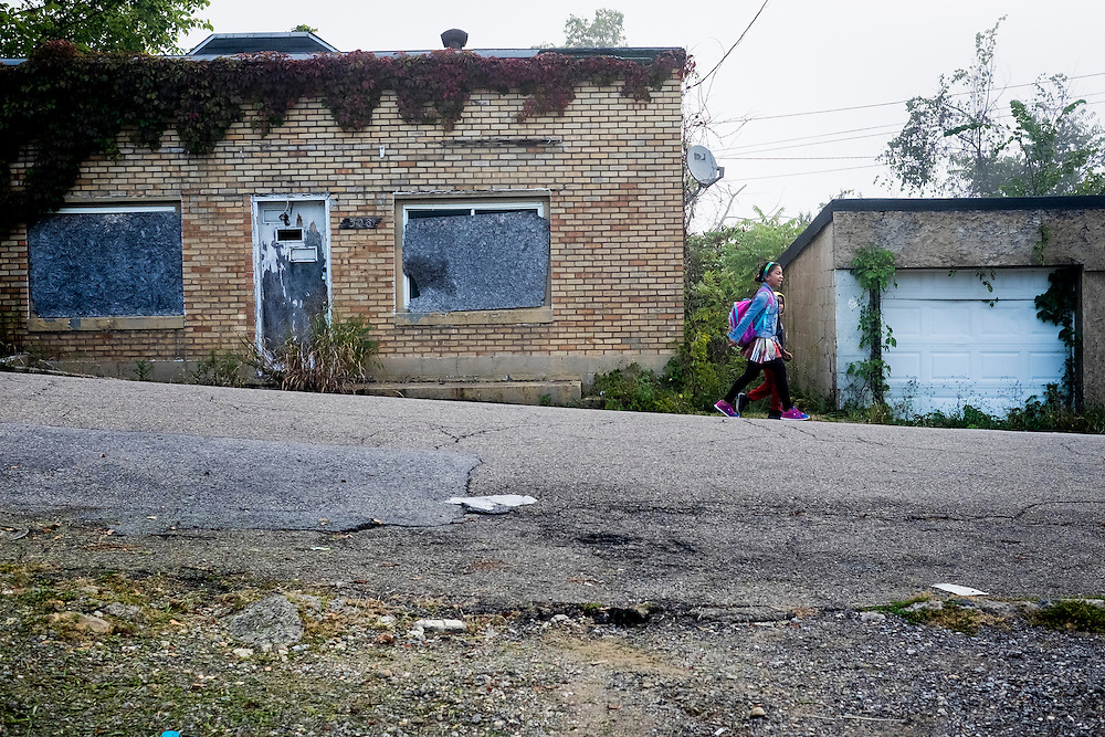 Children walk along the streets of the McDonald Heights neighborhood of Aliquippa, PA. on their way to catch the school bus.<br /> <br /> Since 1987, the city has been designated as a distressed municipality under the state's Act 47, a law that created a recovery program that's helped some 29 municipalities in the state stay afloat.<br /> <br /> The city now has fewer residents now than the local steel mill  had employees (14,000) in its heyday. The mill closed down for good 20 years ago. <br /> <br /> The result has been a spiral or residents leaving and businesses closing down.<br /> <br /> With the lack of good jobs, there is not much in the way of opportunites for the youth of the city.