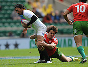 LONDON, ENGLAND - Saturday 10 May 2014, Justin Geduld of South Africa is caught in possession by Bernardo Cardoso of Portugal during the match between South Africa and Portugal at the Marriott London Sevens rugby tournament being held at Twickenham Rugby Stadium in London as part of the HSBC Sevens World Series.<br /> Photo by Roger Sedres/ImageSA