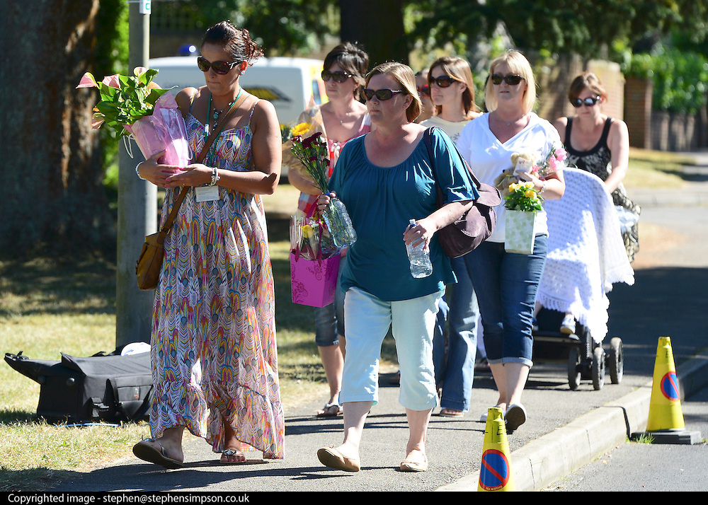 © Licensed to London News Pictures. 07/09/2012. Claygate, UK People lay flowers at the scene. The family home of Saad al-Hilli in Claygate, near Esher. Three members ofof the family have been shot dead in the French Alps. Photo credit : Stephen Simpson/LNP