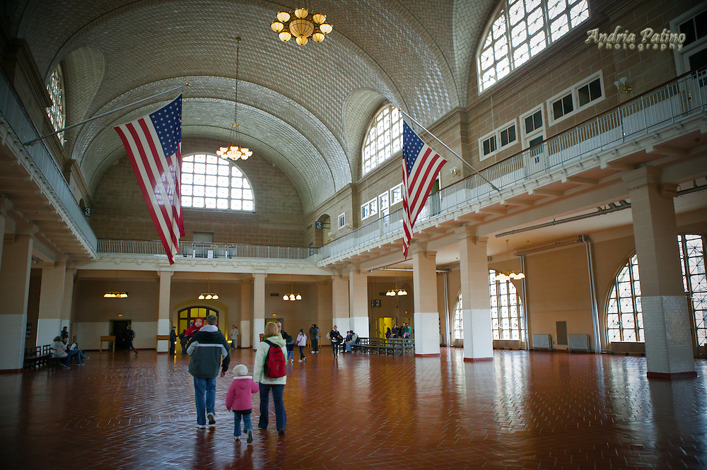 A family visits, Ellis Island's Great Hall where immigrants waited to be interviewed