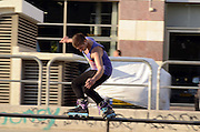 Israel, Tel Aviv, Yad Eliyahu, Urban extreme sport park. Young male performing stunts with roller blades