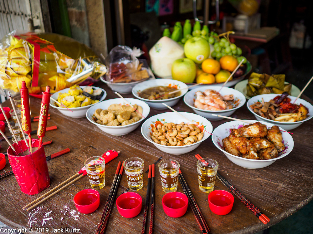 03 FEBRUARY 2019 - BANGKOK, THAILAND: A New Year's banquest set up in the doorway of a family's home in Bangkok's Chinatown diststrict. Chinese New Year celebrations in Bangkok start on February 4, 2019. The coming year will be the Year of the Pig in the Chinese zodiac. About 14% of Thais are of Chinese ancestry and Lunar New Year, also called Chinese New Year or Tet is widely celebrated in Chinese communities in Thailand.         PHOTO BY JACK KURTZ