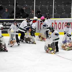 COBOURG, ON - Dec 16 : Ontario Junior Hockey League Game Action between the Cobourg Cougars and the Kingston Voyageurs, Cobourg Cougars Hockey Club teddy bear toss during first period game action.<br /> (Photo by Andy Corneau / OJHL Images)
