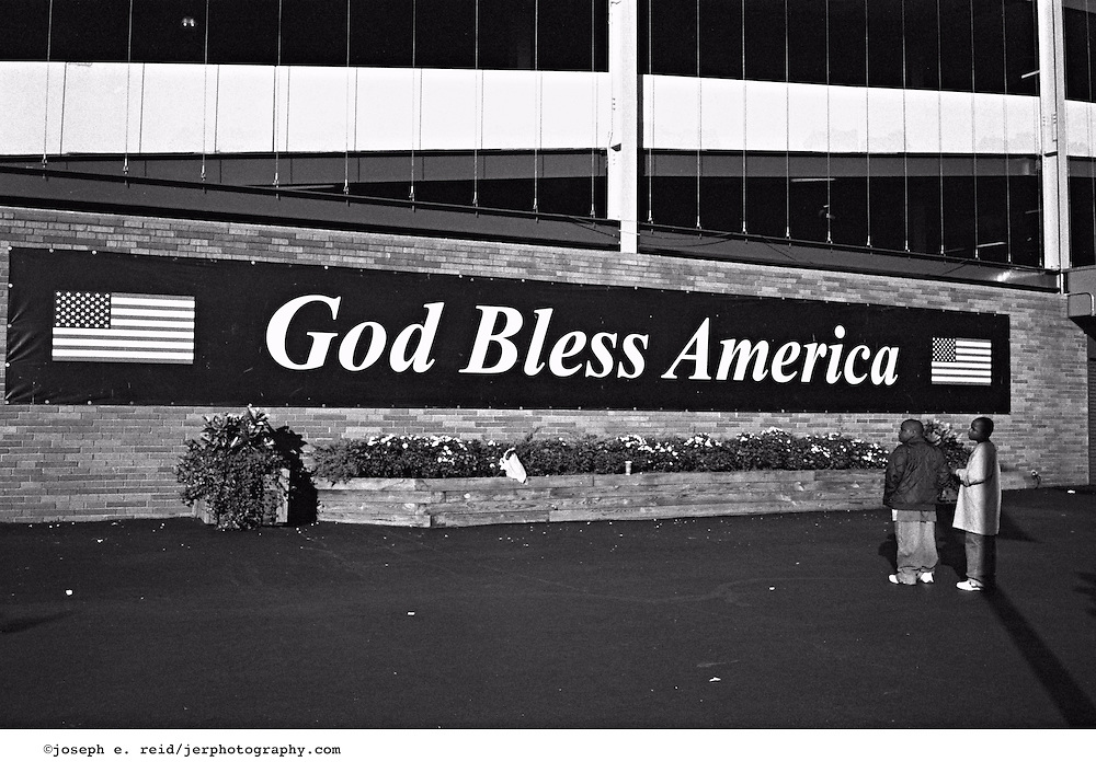 "American flags and ""God Bless America"" sign outside Shea Stadium, Queens, New York"