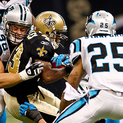 January 1, 2012; New Orleans, LA, USA; New Orleans Saints running back Darren Sproles (43) is brought down by Carolina Panthers defenders defensive end Thomas Keiser (98), linebacker Jordan Senn (57), and cornerback Cletis Gordon (25) during the second half of a game at the Mercedes-Benz Superdome. The Saints defeated the Panthers 45-17. Mandatory Credit: Derick E. Hingle-US PRESSWIRE