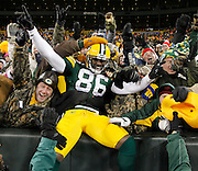 Green Bay Packers' Donald Lee(86) celebrates with fans after catching a touchdown pass in the second half during their NFL football game against the Chicago Bears in Green Bay, Wisconsin January 2, 2011.