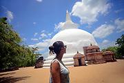 Young woman and Dagaba Kiri Vihara, built in honour of the king`s queen, in The Ancient City Polonnaruwa, Sri Lanka