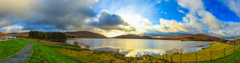 The other weekend I had a chance to get to one of my favourite places - Spelga Reservoir. Sadly the light dusting of snow which had been over the Mournes the day before was pretty much all gone, but the clouds broke nicely while I was there appreciating the view to light up the reservoir and the peaks of Cock Mountain and Slievenamiskan off to the right with a nice golden glow.<br />